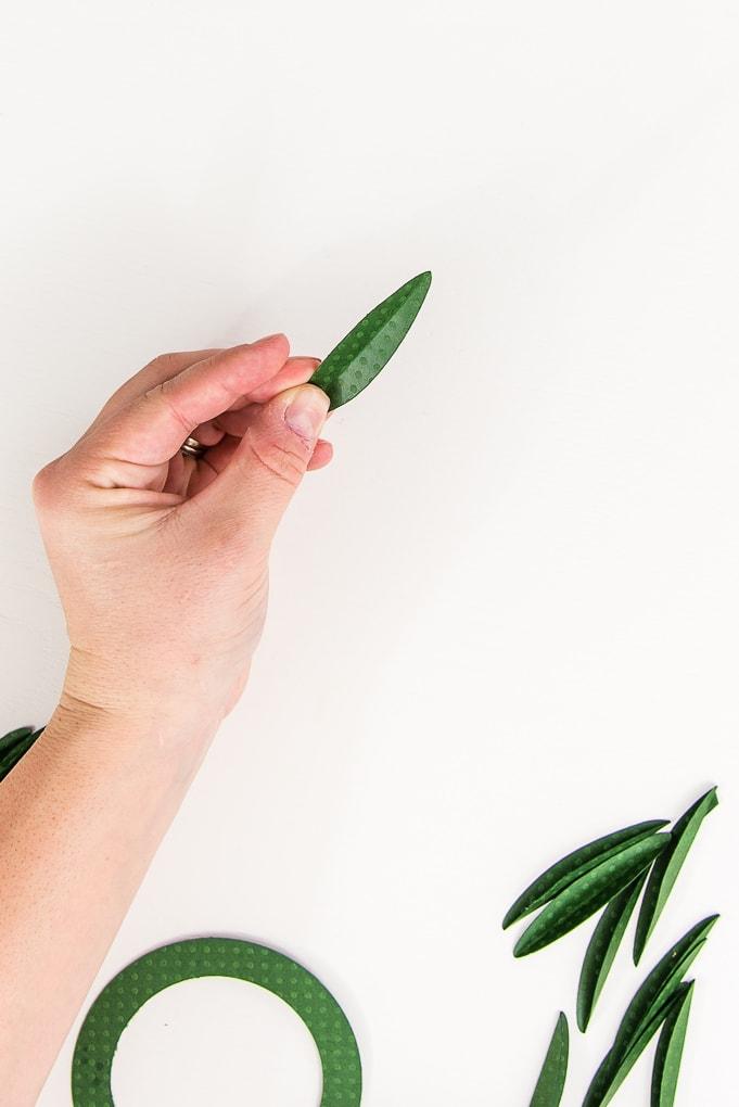 close up of green paper leaf folded