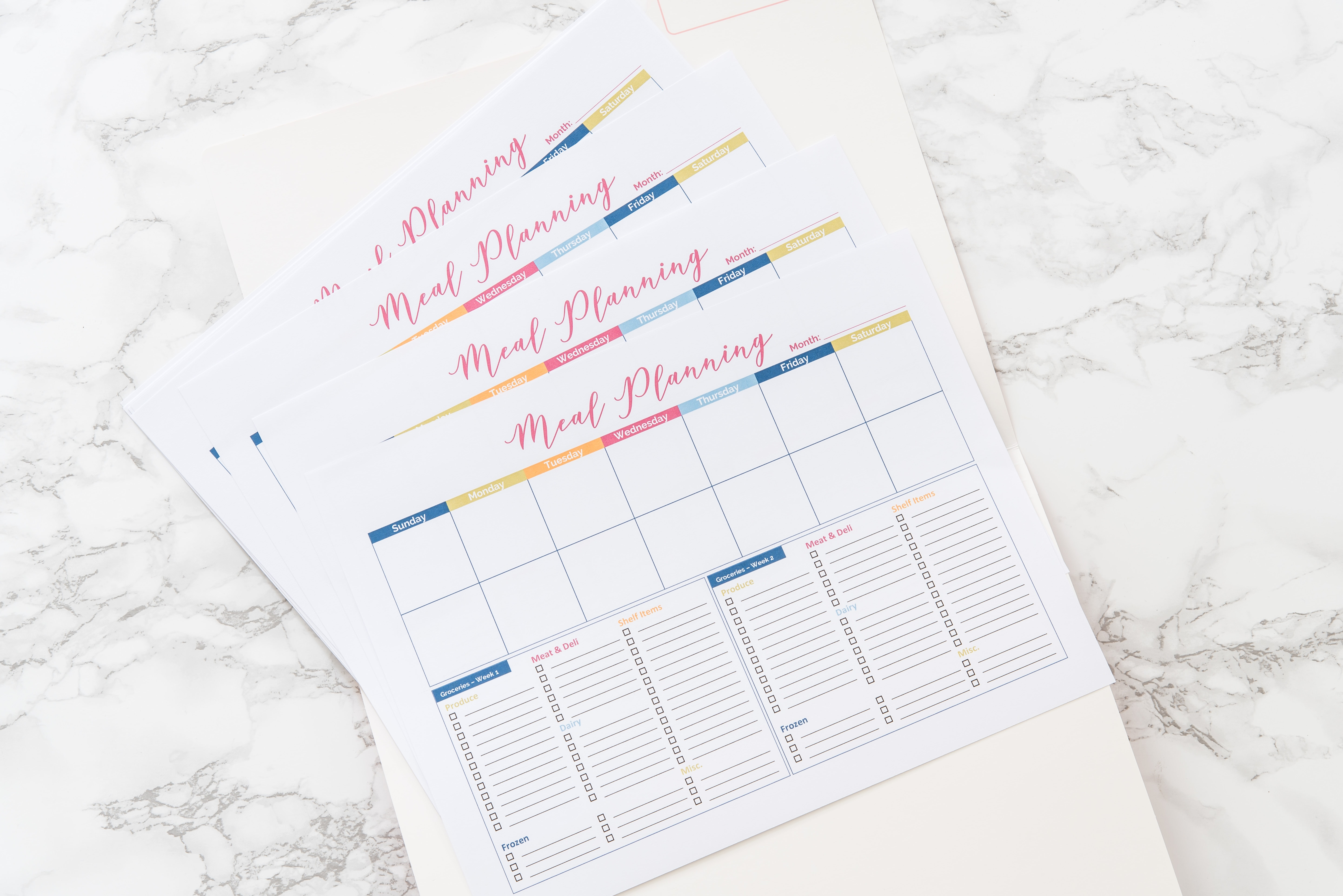 colorful meal planning printables in white file folder