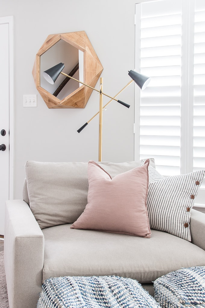 Ella floor lamp behind reading chair from Brightech the best modern accent lamp
