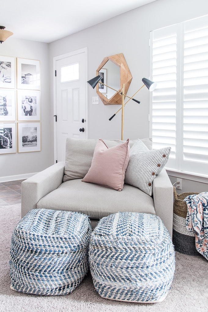 reading nook with chair, modern floor lamp, and poufs in a home office