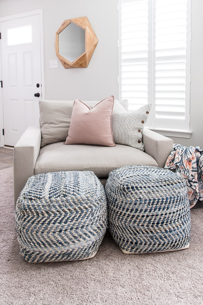 blue pattern poufs in front of the harmony chair from west elm in modern office