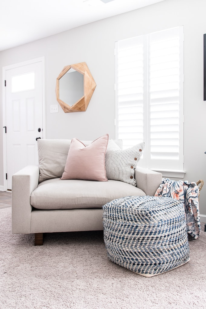 harmony accent chair in the color ash from west elm with throw pillows