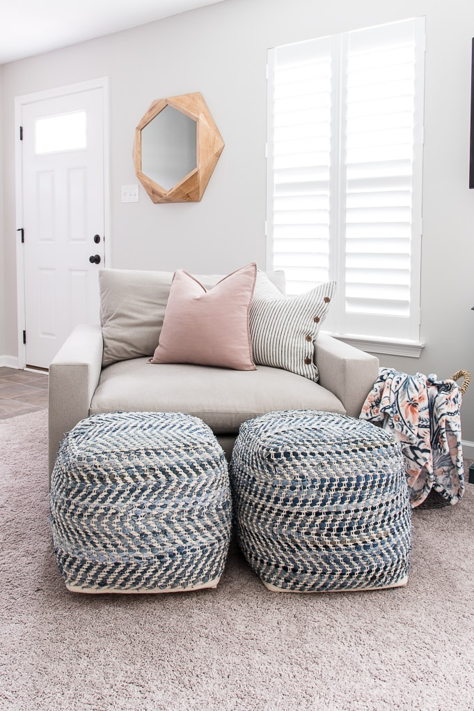 blue pattern poufs in front of the harmony accent chair in the color ask from west elm