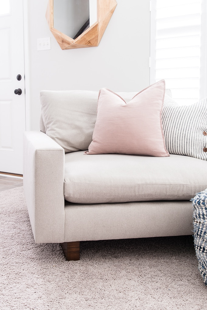 pink throw pillow on the harmony oversized chair and a half from west elm