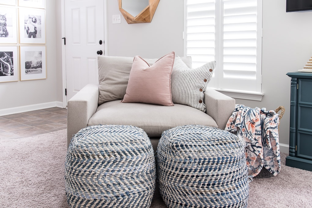 blue pattern poufs in front of the harmony accent chair from west elm color ash