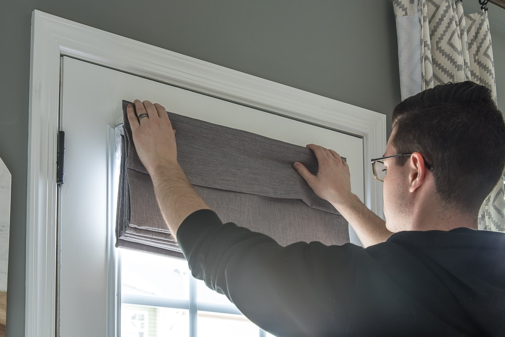 mounting a gray roman shade to door outside mount