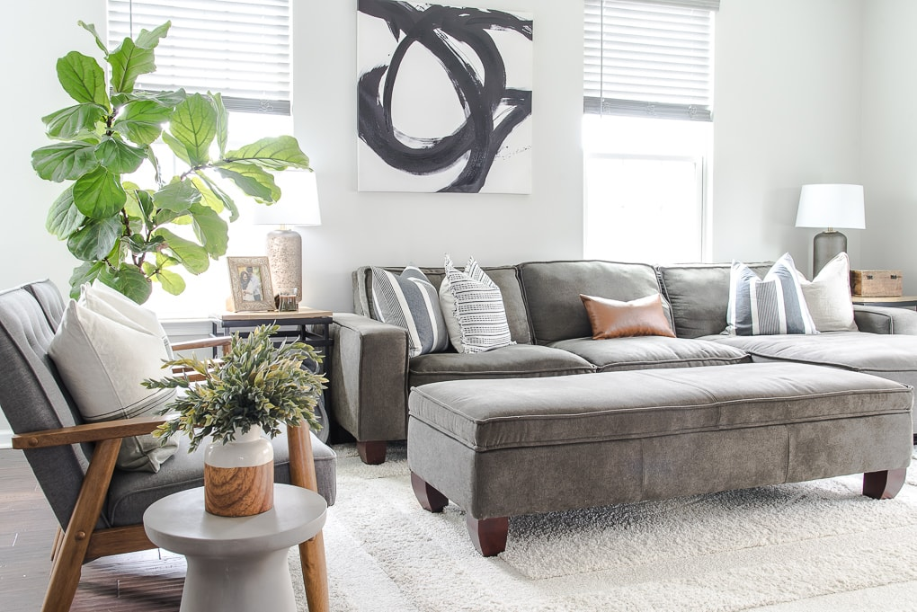 spring living room decorated with gray couch and modern home decor