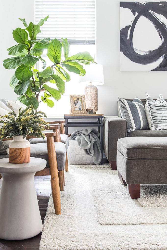 end table with felt basket blue blanket and modern classic home decorations and gray couch