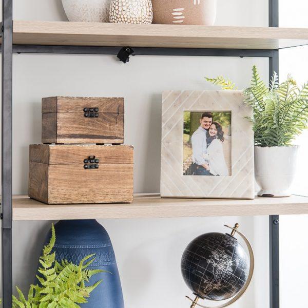 modern home decor on bookshelf in living room traditional
