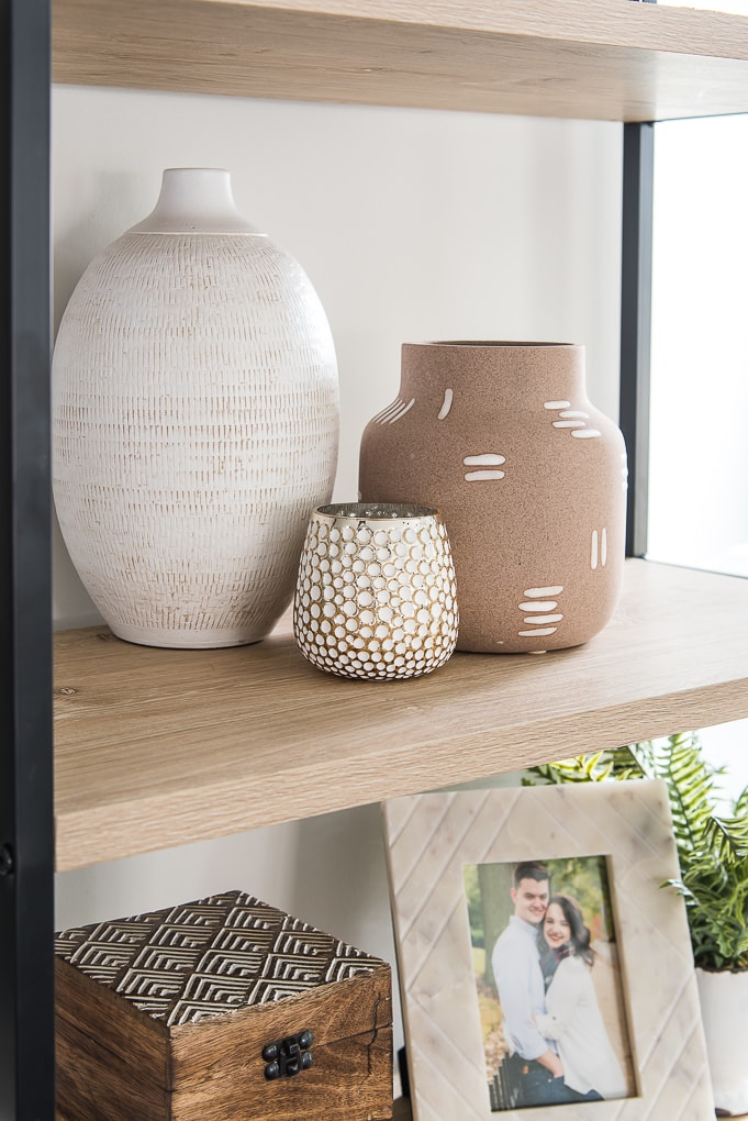 trio of spring vases on bookshelf