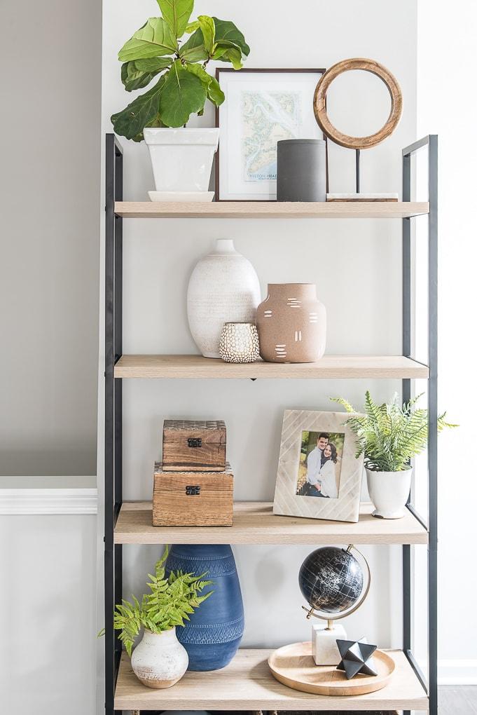 modern bookshelf with spring decor in living room