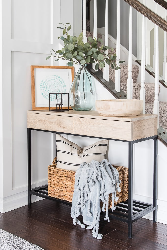 decorated console table for spring in a dining room with spring decor