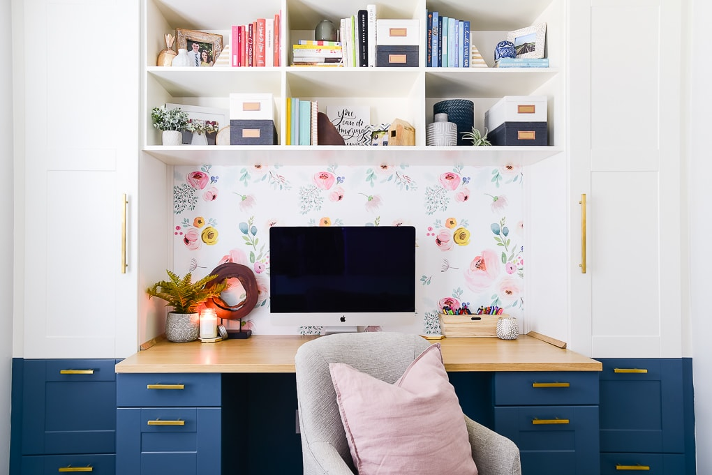 modern creative desk with imac computer and shelf decor with books