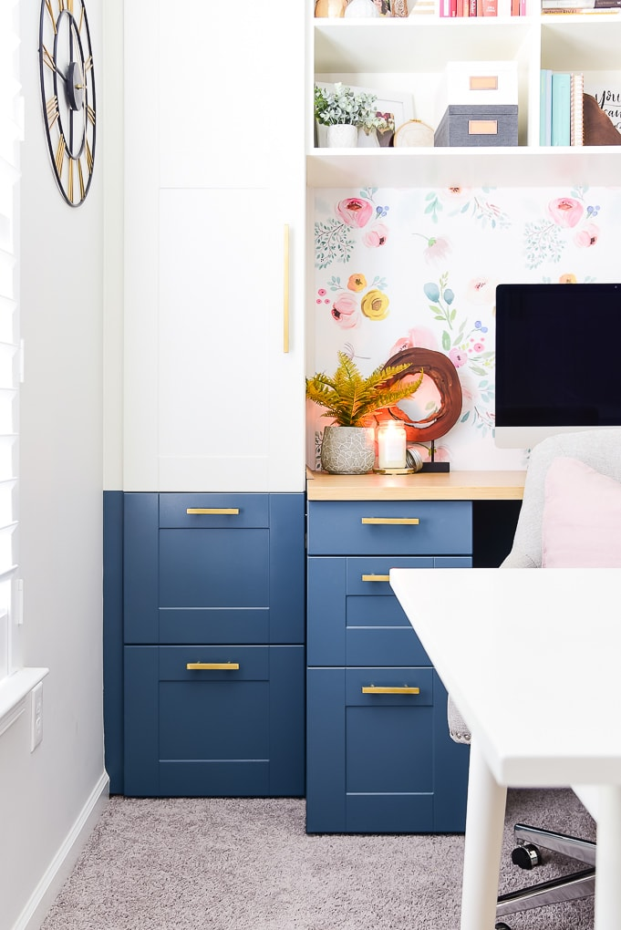 blue desk cabinets with decorations and candle