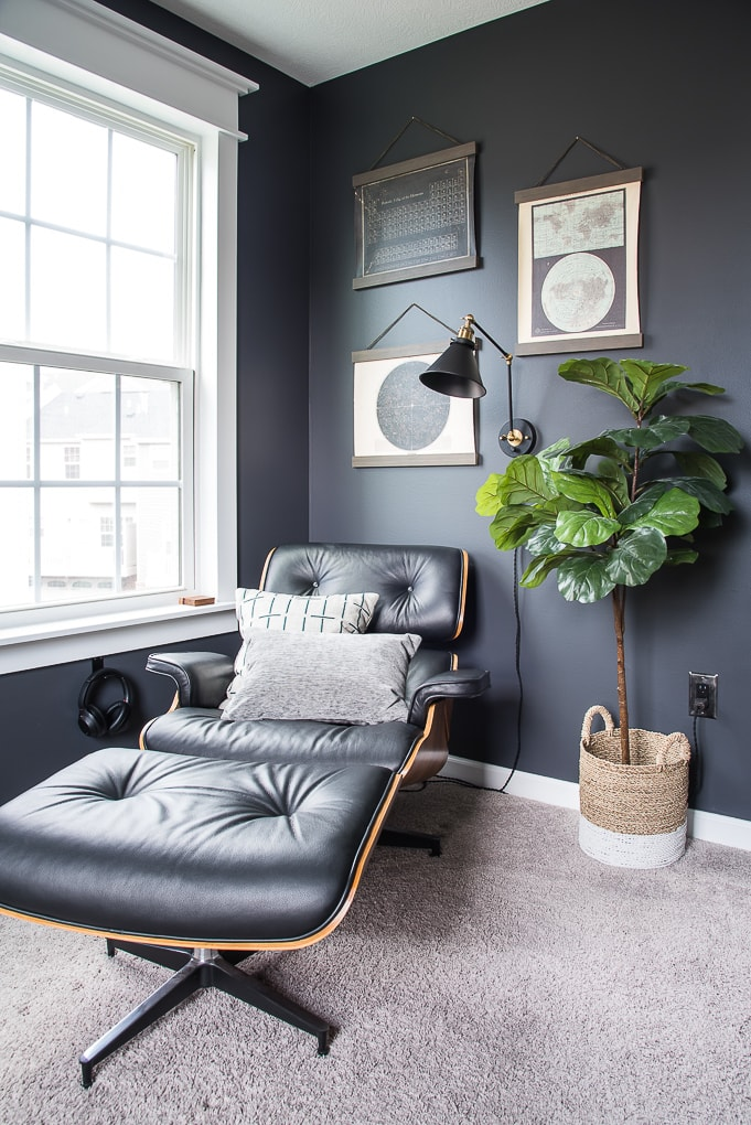 modern masculine office lounge chair and fiddle leaf fig tree in industrial office