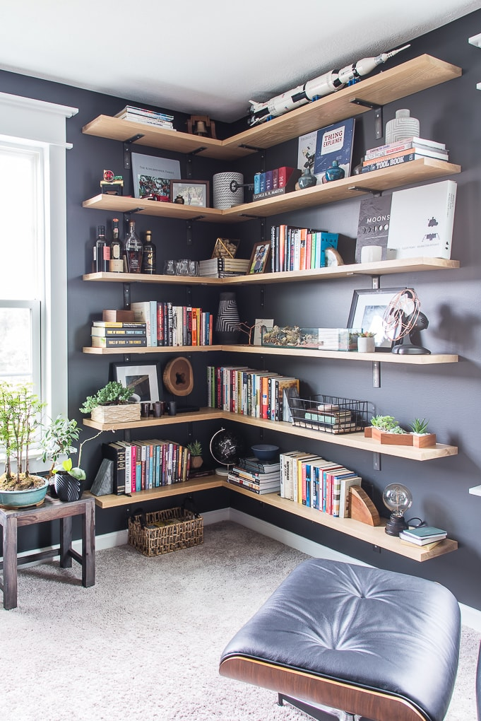 floating industrial shelves in modern masculine home office