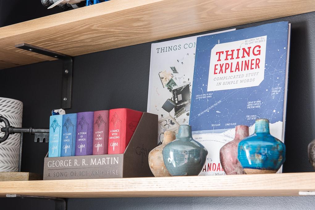 books and vases on shelves