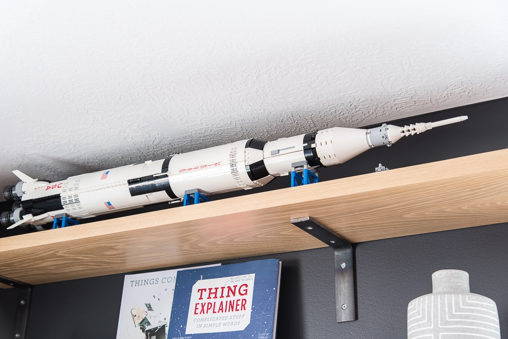 lego saturn 5 rocket on a shelf