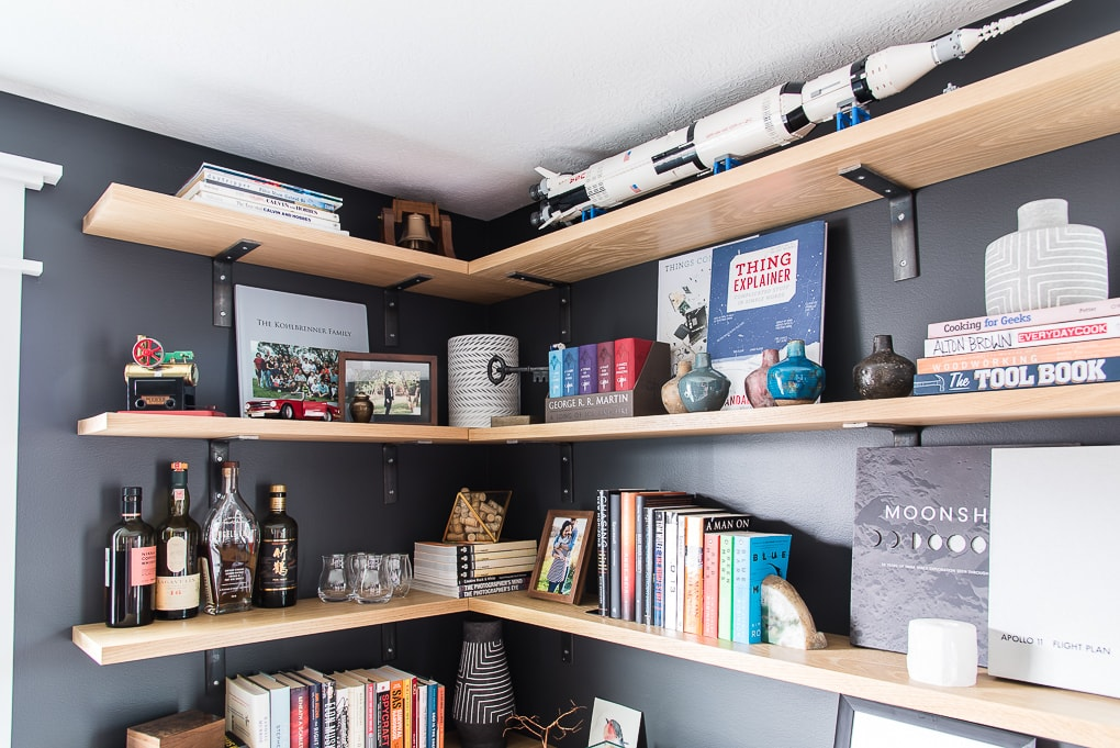 upper floating shelves with books and decorations