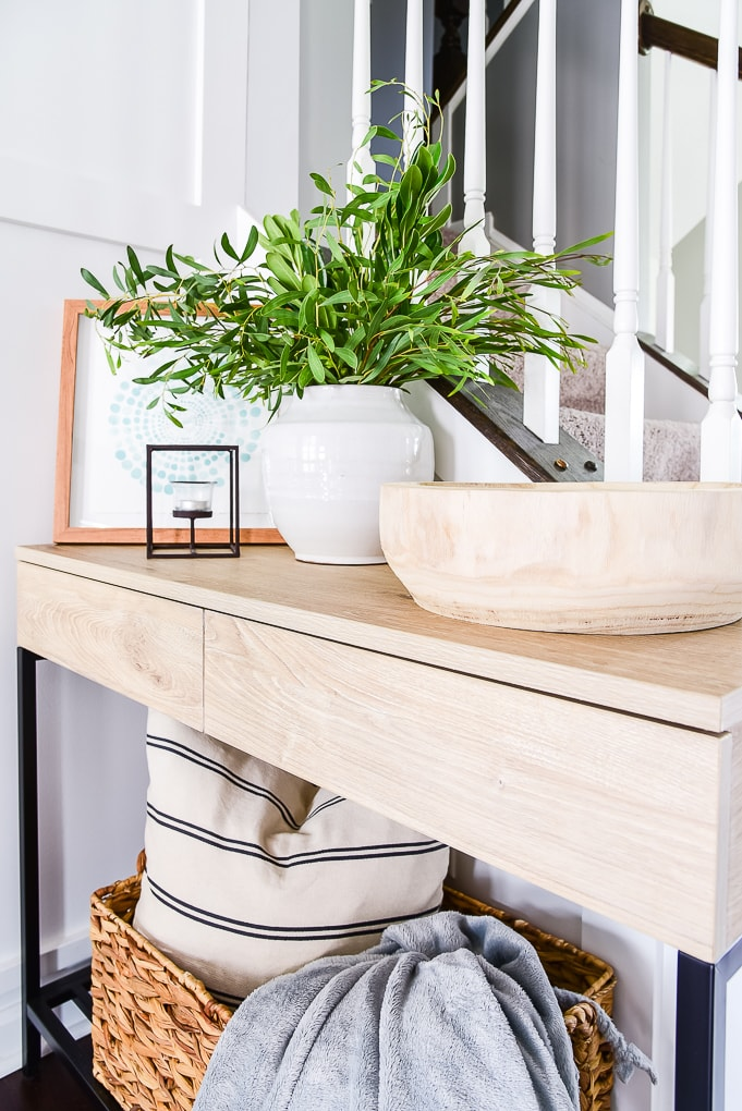 natural wood console table with modern decorations on the top