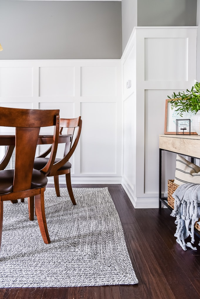 dining room with gray rug and natural wood console table
