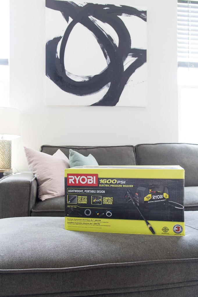 Ryobi power washer in box in living room