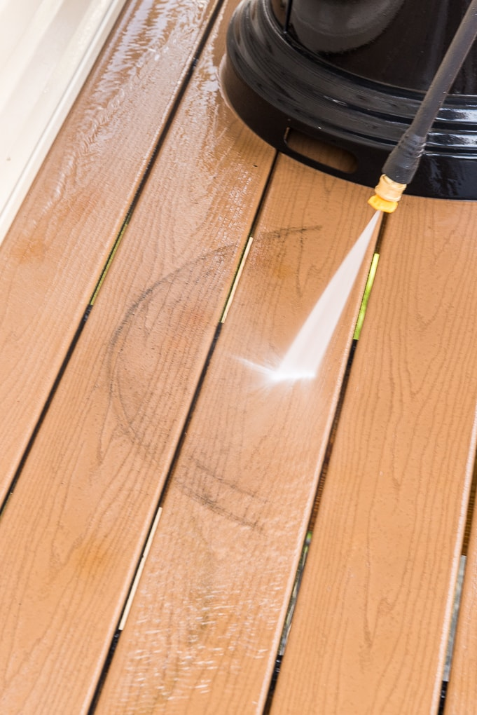 power washing a deck floor with Ryobi power washer