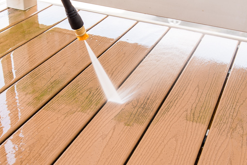 removing grime from deck with Ryobi power washer
