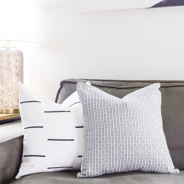 woven nook pillows on a couch left