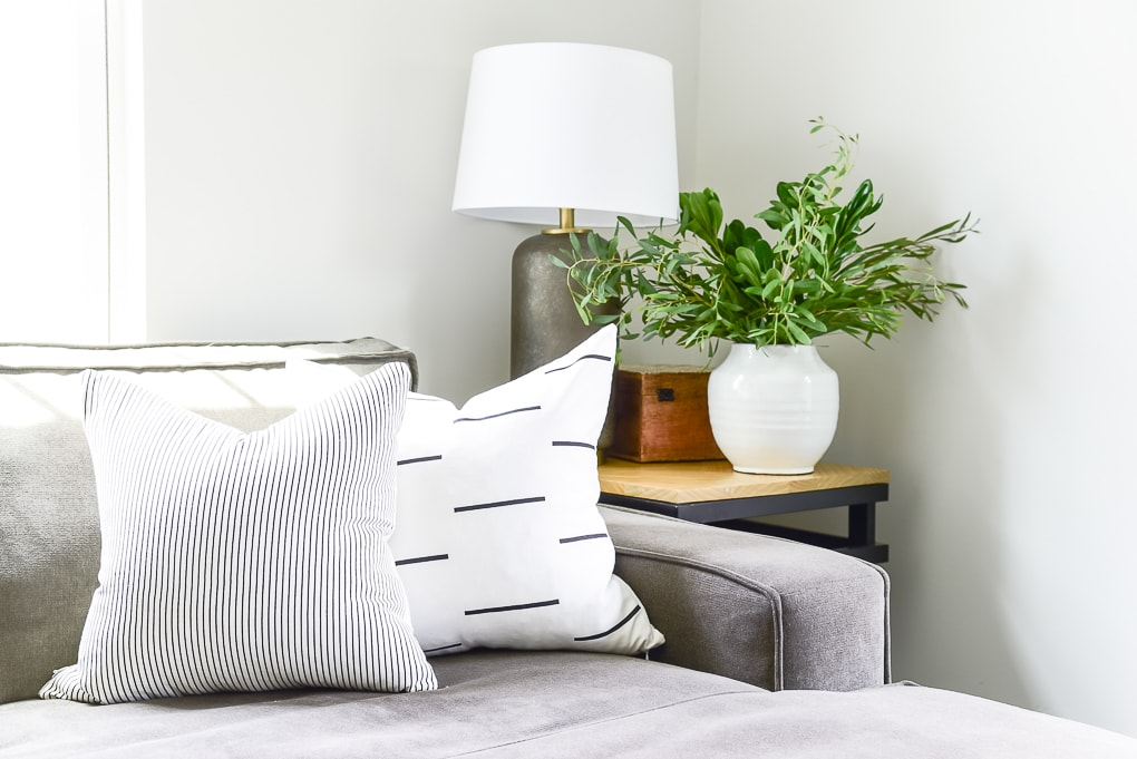woven nook pillows on a couch right