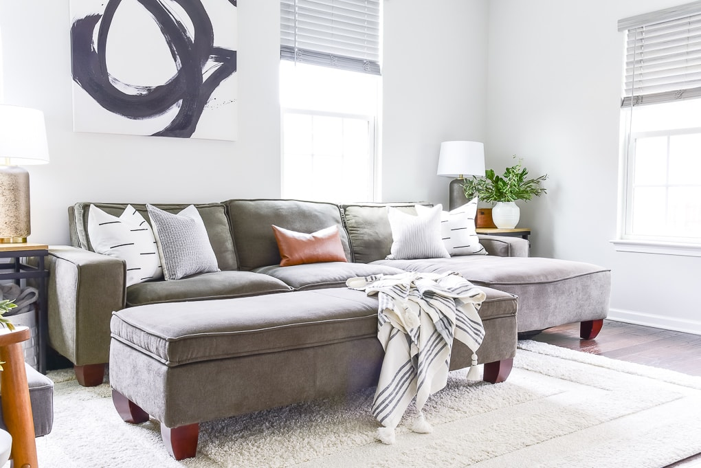 modern couch in living room with woven nook pillows
