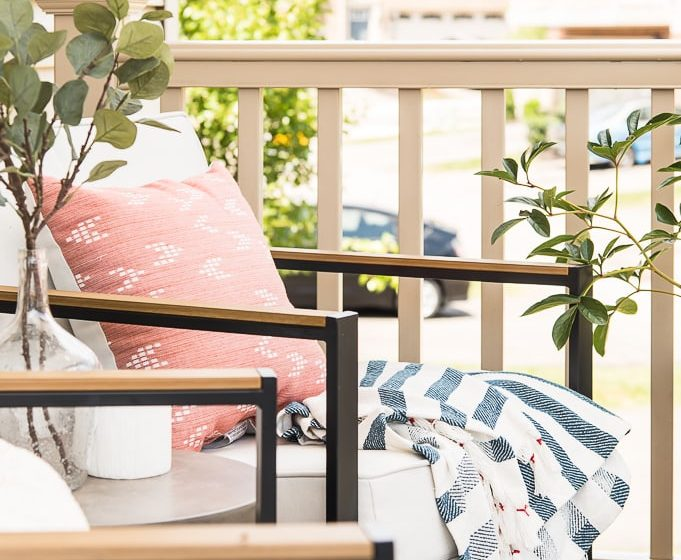 outdoor chair with pillow and blanket on porch