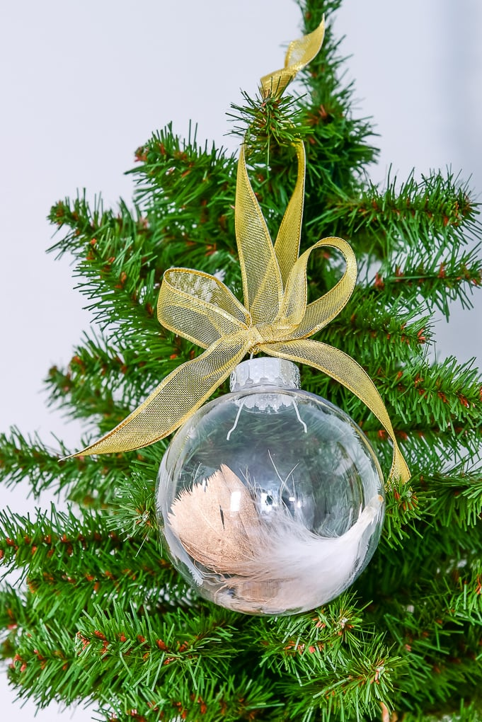 closeup of easy gold-dipped feather Christmas ornament on Christmas tree