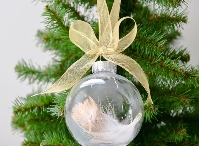 easy gold-dipped feather Christmas ornament on Christmas tree with gold ribbon bow