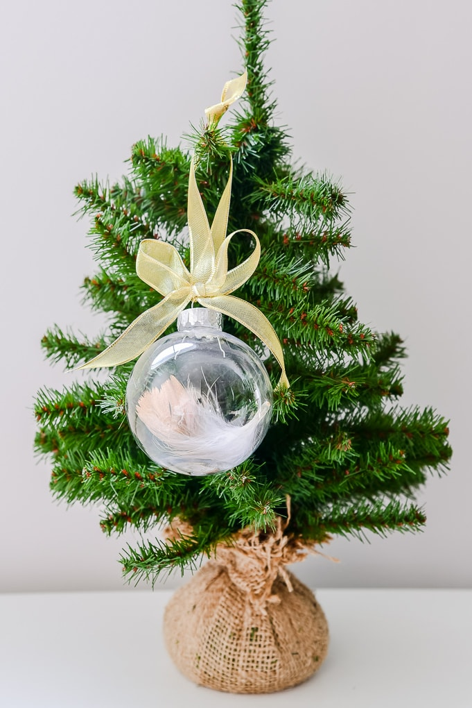 easy gold-dipped feather Christmas ornament on Christmas tree on tiny Christmas tree
