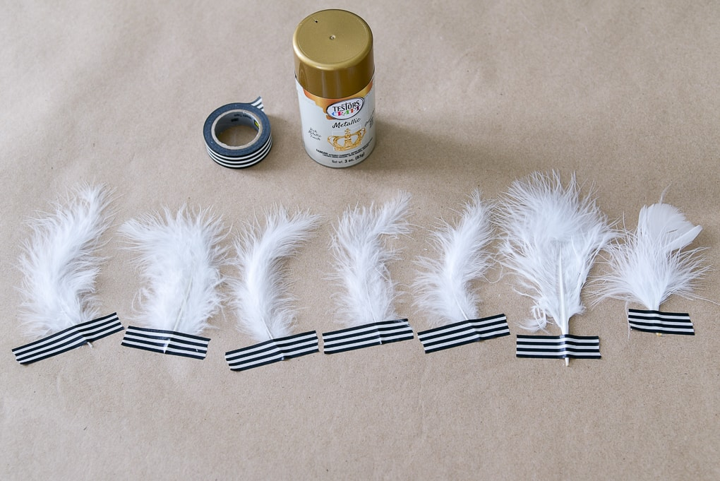 white feathers washi taped to brown kraft paper