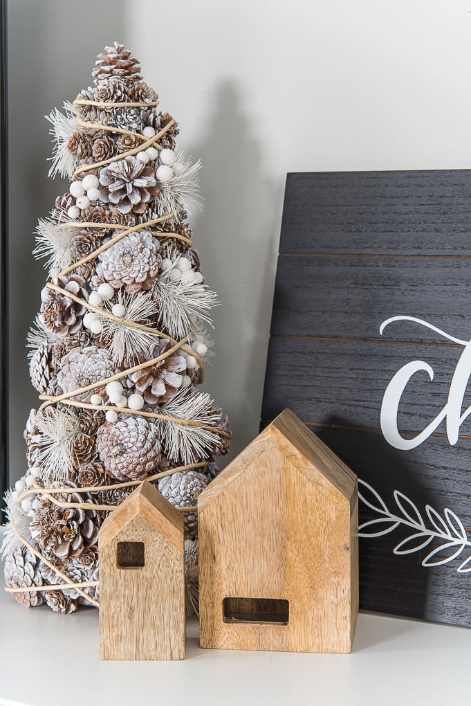 Pinecone Christmas tree decor and small wooden houses