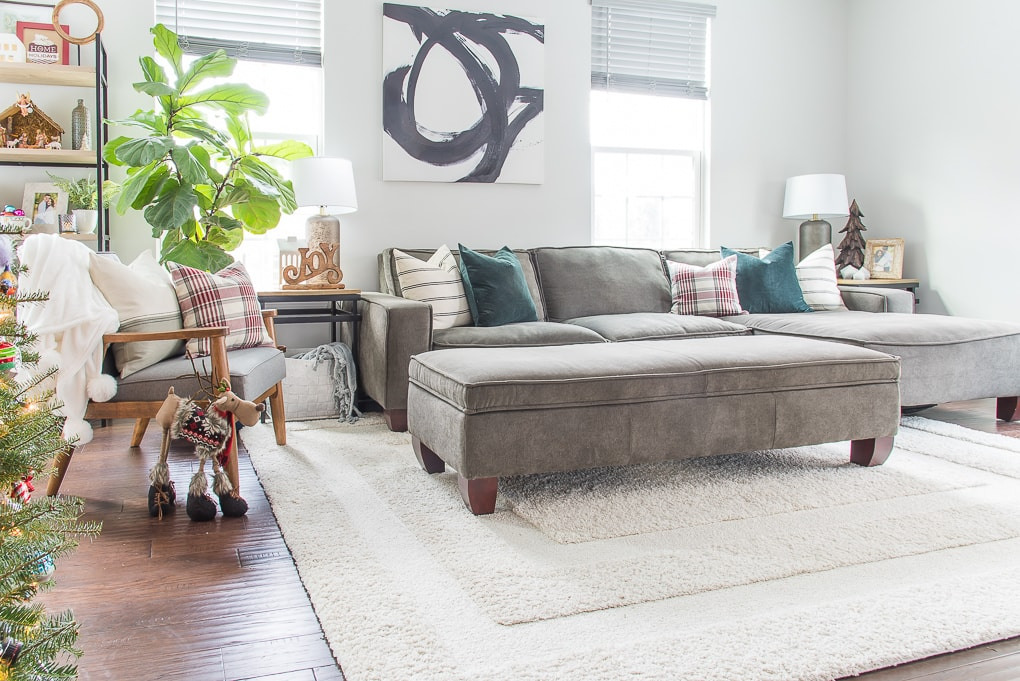 Christmas living room with gray sectional couch