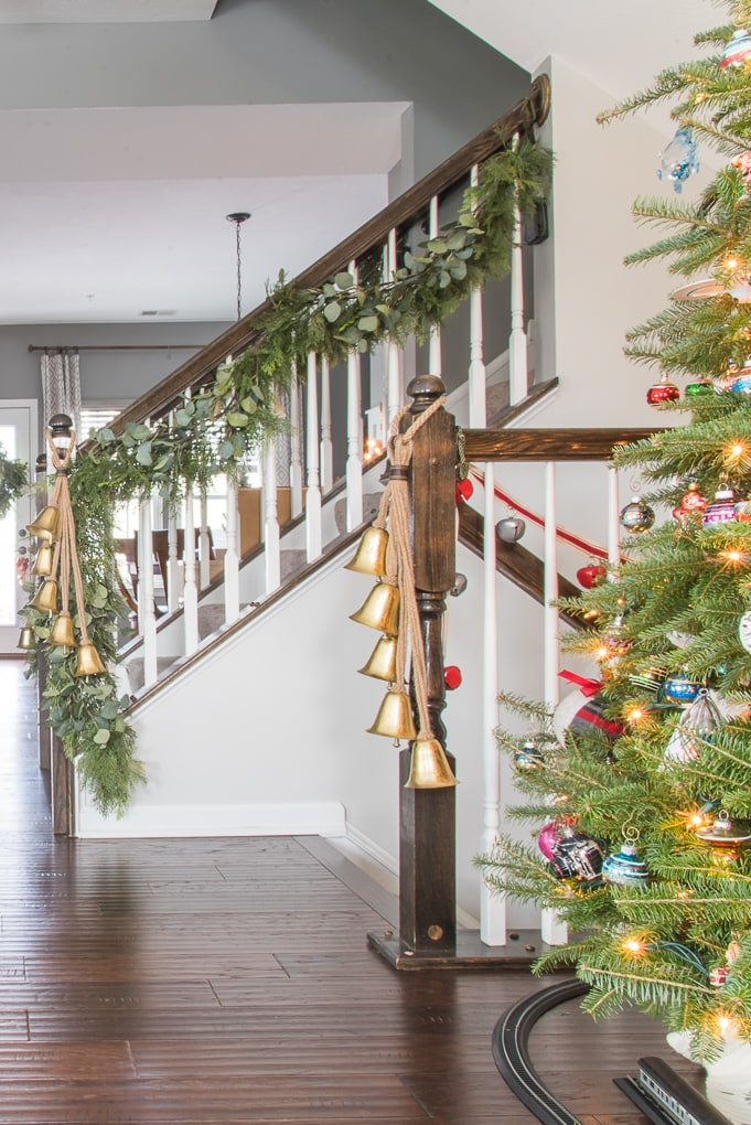 faux greenery Christmas garland on staircase