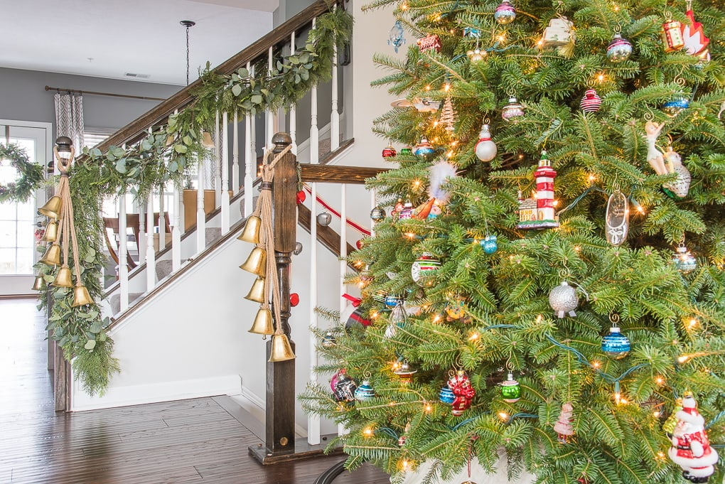 Fresh Christmas tree with family ornaments in modern classic home
