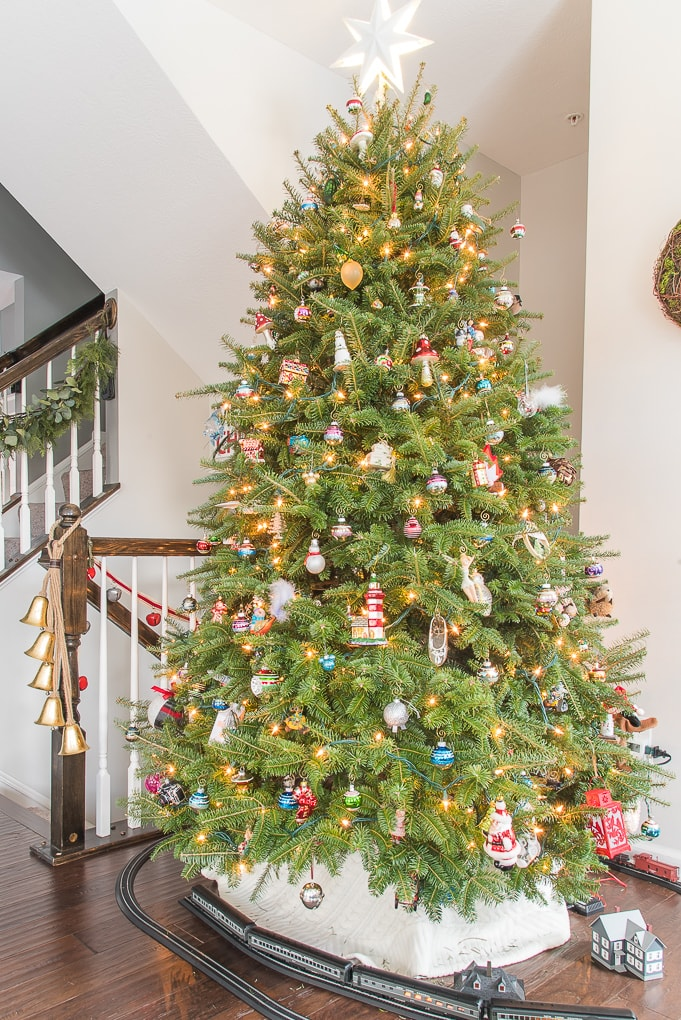 Traditional Fresh Christmas tree with family ornaments