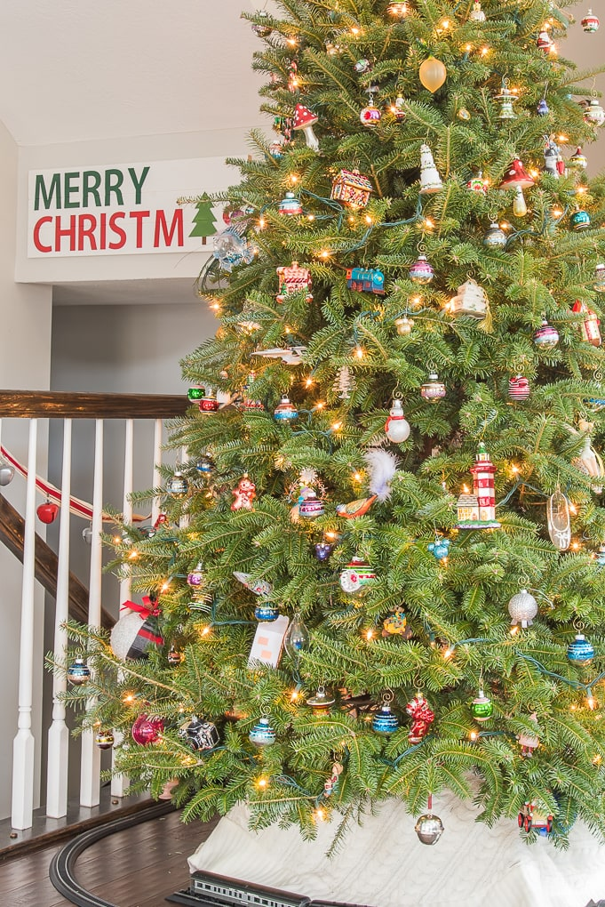close up of fresh Christmas tree with family ornaments