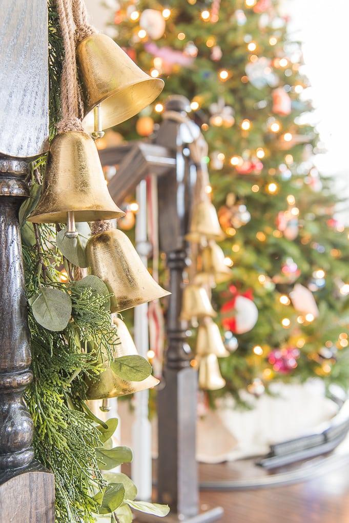 golden bells Christmas decor on staircase