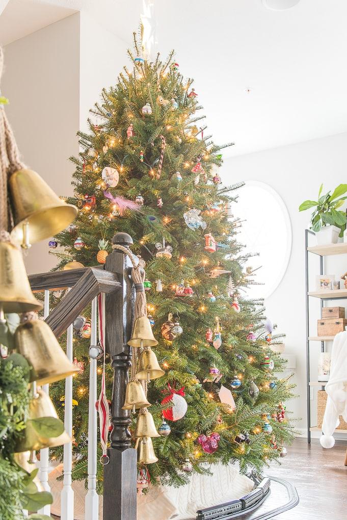 fresh Christmas tree in living room Christmas home tour