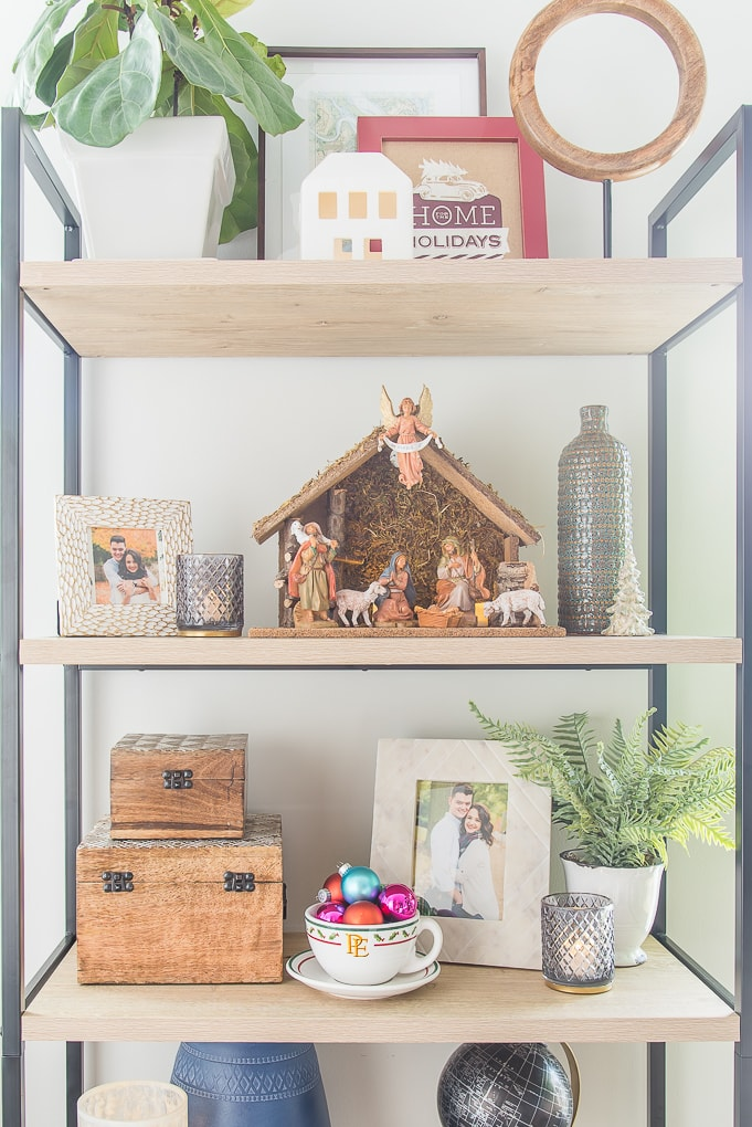 Christmas decorated shelves with nativity