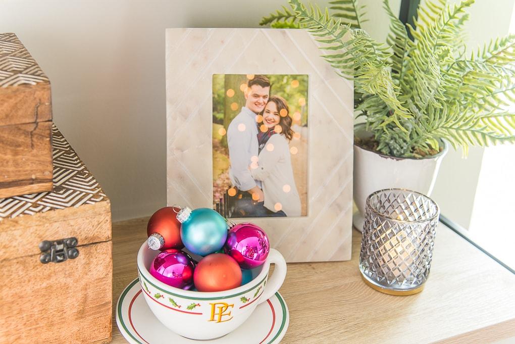 Colorful Christmas ornaments in hot chocolate mug