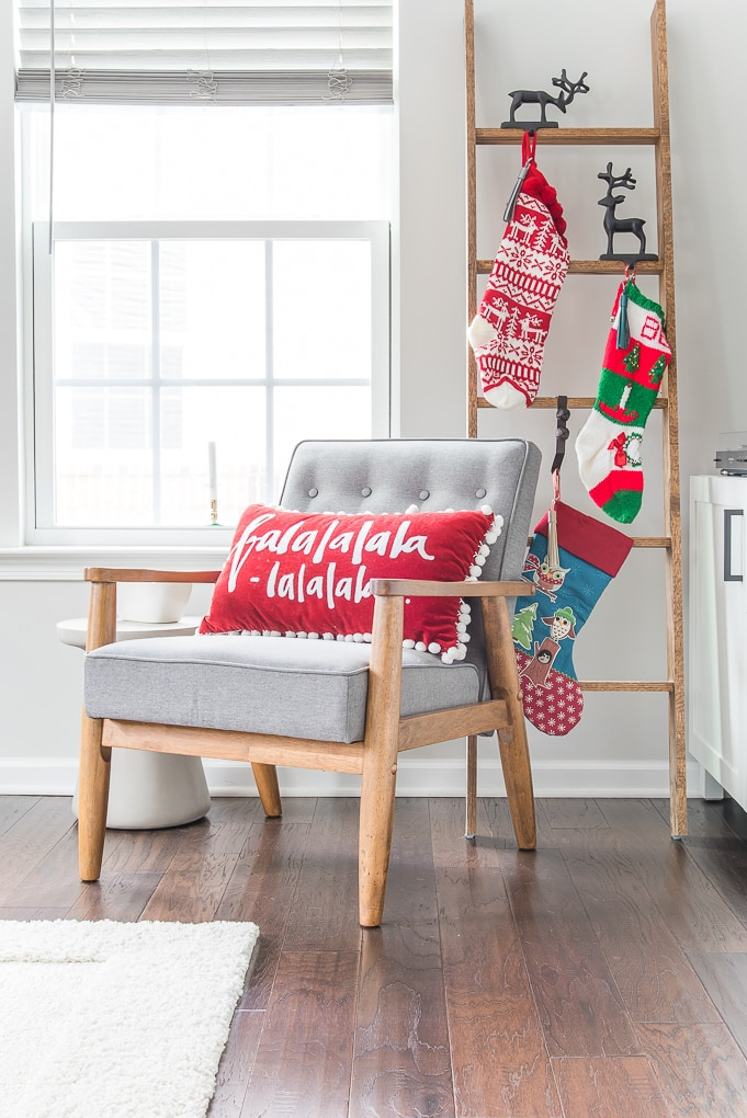 Christmas stocking ladder and accent chair decor