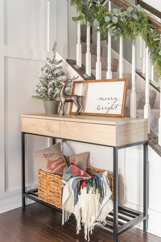 Modern console table decorated for Christmas home tour