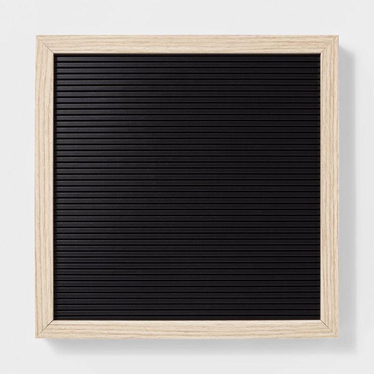 black blank letter board with light wood frame