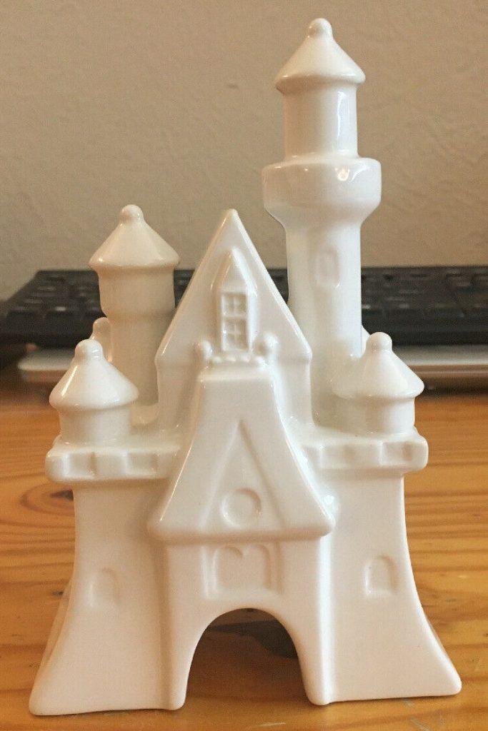 white ceramic Disney cinderella castle baby nursery